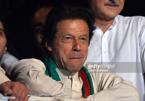 Pakistani cricketerturned politician Imran Khan attends a rally after a populist cleric issued a 48hour ultimatum demanding the arrest of Prime...
