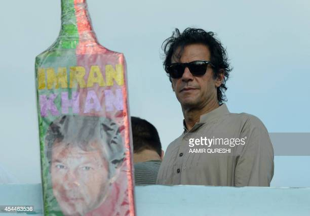 Pakistani cricketerturned politician Imran Khan looks on from the stage during an antigovernment protest near the prime minister's residence in...