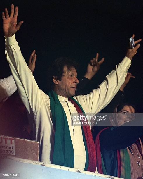 Pakistani cricketerturned politician Imran Khan waves to supporters as he attends a rally after a populist cleric issued a 48hour ultimatum demanding...