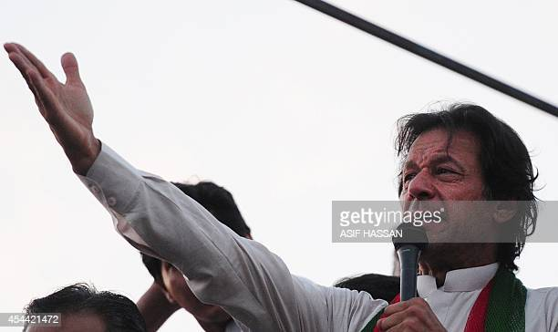 Pakistani cricketerturnedpolitician Imran Khan addresses supporters near the prime minister's residence following clashes with riot police in...