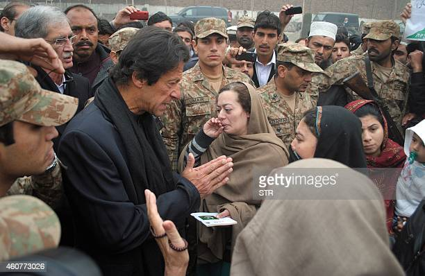 Pakistani cricketerturnedpolitician Imran Khan meets with family members of slain schoolchildren on the premises of an armyrun school in Peshawar on...