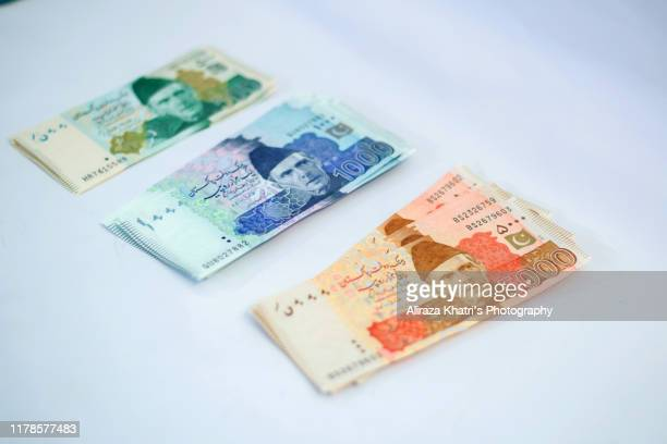 pakistani currency - pakistan stock pictures, royalty-free photos & images
