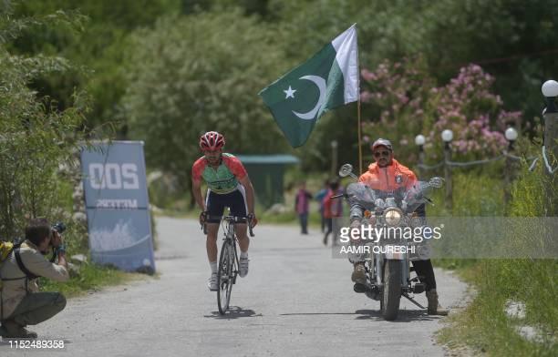Pakistani cyclist takes part in Tour de Khunjrab cycling race in Duikar Altit in northern Pakistan's Hunza region on June 28, 2019. - One of the...