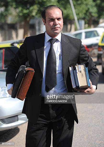 Pakistani defence lawyer Shahbaz Rajput arrives at Adiala jail for a hearing in Rawalpindi on October 10 2009 Seven suspects accused by India of...