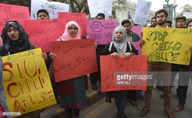 Pakistani demonstraters carry placards during a protest against the rape and murder of a child in Lahore on January 11 2018 At least two people were...