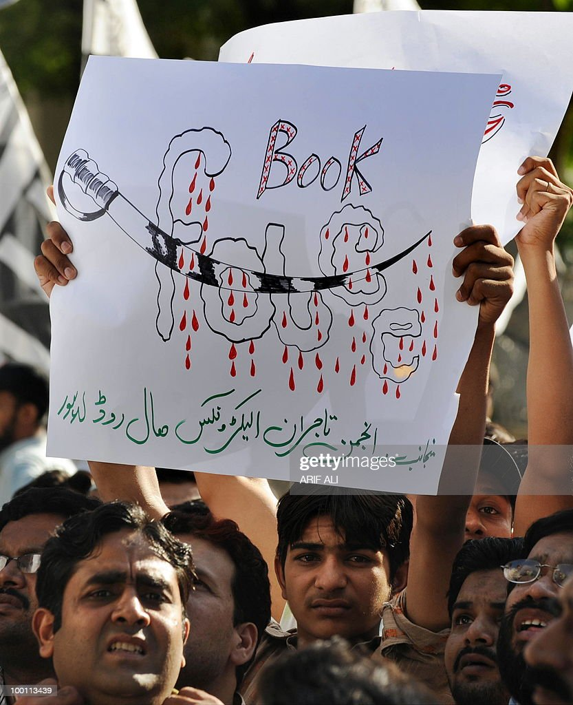 A Pakistani demonstrator holds up a placard during a protest in Lahore on May 21, 2010, against the published caricatures of Prophet Mohammed on Facebook. Pakistani protesters shouted 'Death to Facebook', 'Death to America' and burnt US flags, venting growing anger over 'sacrilegious' caricatures of the Prophet Mohammed on the Internet. A Facebook user organised an 'Everyone Draw Mohammed Day' competition to promote 'freedom of expression', inspired by an American woman cartoonist, but sparked a major backlash in the conservative Muslim country of 170 million. Islam strictly prohibits the depiction of any prophet as blasphemous and the row has sparked comparison with protests across the Muslim world over the publication of satirical cartoons of Mohammed in European newspapers in 2006.