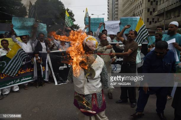 Pakistani demonstrators burn an effigy of Indian Prime Minister Narendra Modi in a protest in Karachi on August 15 as they observe 'Black Day' on the...