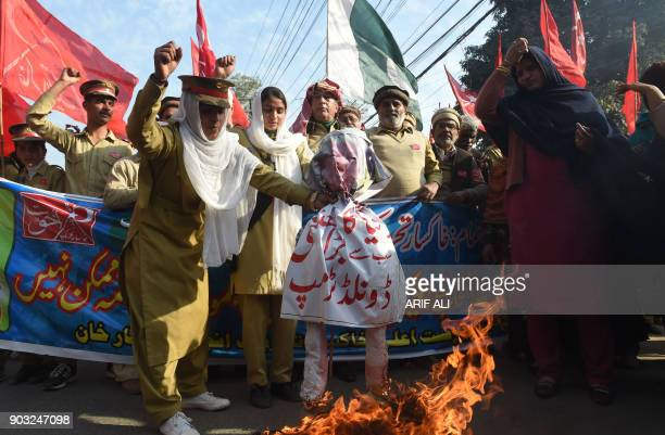 Pakistani demonstrators burn an effigy of US President Donald Trump during an antiUS protest in Lahore on January 10 2018 Washington's freeze on...