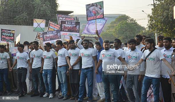 Pakistani demonstrators from Youth Forum For Kashmir shout slogans during a protest rally against India's decision to add to India a majorityMuslim...