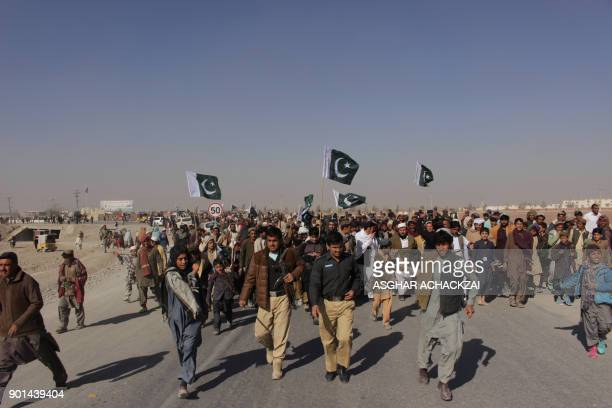 Pakistani demonstrators gather during a protest against US aid cuts at the PakistanAfghanistan border post in Chaman on January 5 2018 The United...