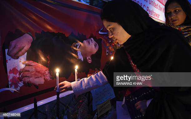 Pakistani demonstrators light candles during a vigil for victims of the Peshawar school massacre in Quetta on December 21 2014 AlQaeda's regional...