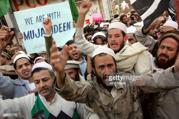 Pakistani demonstrators shouts antiAmerican slogans during a protest by January 20 2006 in Peshawar Pakistan Several thousand demonstrators marched...