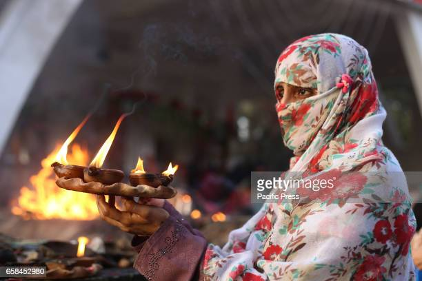 Pakistani devotee attends the last day of three days 429th annual Urs 'Festival of lights' at the shrine of Muslim Sufi saint Shah Hussain popularly...