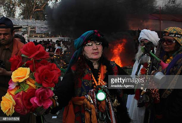 Pakistani devotee dance front of fire at the shrine of Sufi saint Shah Hussain popularly known Madhu Lal Hussain on the 426th anniversary of his...