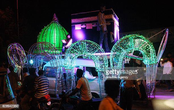 Pakistani devotee look the Models of MasjideNabawi and KhanaeKaba on the eve of an annual religious festival EideMiladun Nabi the birth anniversary...