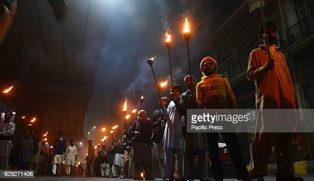 Pakistani devotee Muslims attend the celebration on Mawlid alNabi the birth anniversary of Prophet Mohammed in Lahore Pakistani Muslims lights...