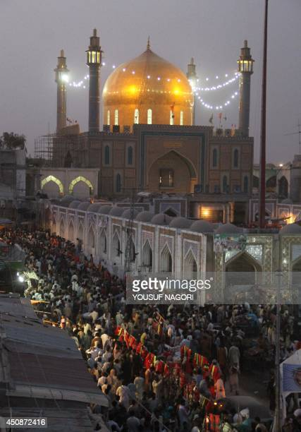 Pakistani devotees gather on June 18 2014 at the shrine of 13th century Muslim Sufi saint Lal Shahbaz Qalandar in Sehwan 250 kilometres north of...