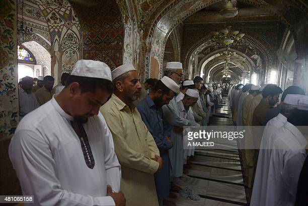 Pakistani devotees offer prayers on the last Friday of Ramadan ahead of the Eid alFitr holiday in Peshawar on July 17 2015 Millions of Muslims around...