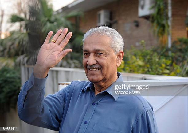Pakistani disgraced nuclear scientist Abdul Qadeer Khan waves to his supporters as he walks in a garden in Islamabad on February 7 2009 Pakistan...