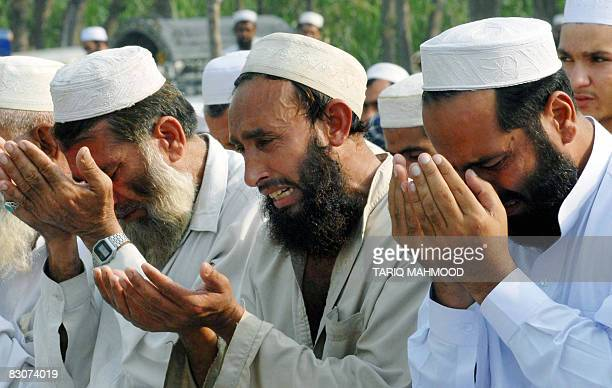 Pakistani displaced tribesmen from the troubled district of Bajaur weep as they offer 'Eid alFitr' prayers at a makeshift camp in Mardan on October 1...