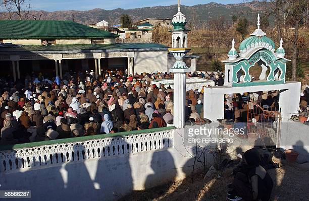Pakistani earthquake survivors offer their morning prayers 11 January 2006 at a mosque in Jaba Sheepfoom near Balakot on the occasion of the Muslim...