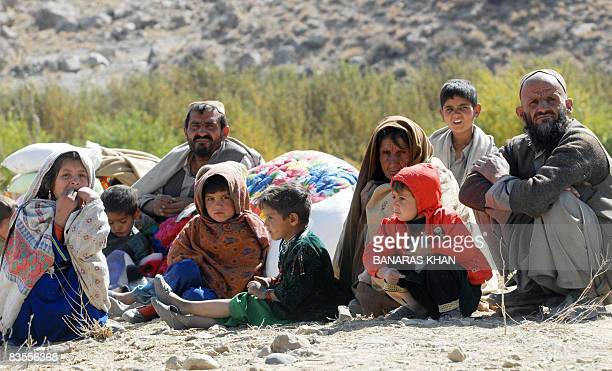 Pakistani earthquake survivors wait for relief supplies at a hilly area of Killy Kach one of about eight sparsely populated villages surrounding the...
