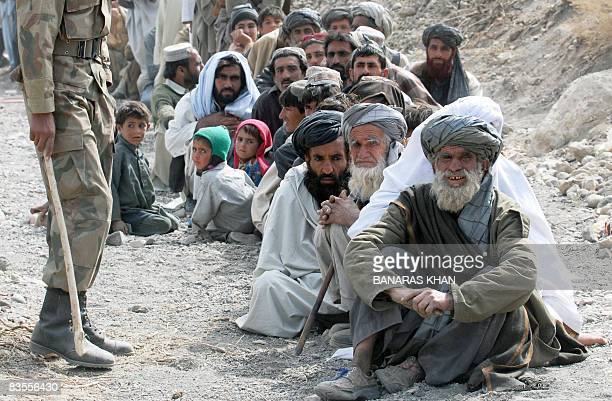 Pakistani earthquake survivors wait for relief supplies at a hilly area of Wam one of about eight sparsely populated villages surrounding the town of...