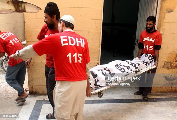 Pakistani emergency workers from a largest private charity organization Edhi carry the body of a TehrikiTaliban Pakistan militant at the hospital in...