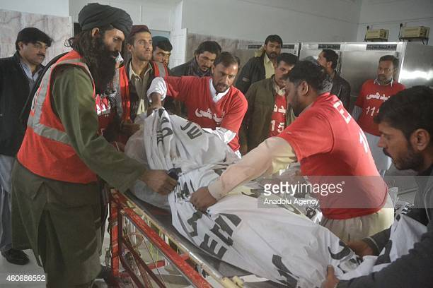 Pakistani emergency workers shift a body of TehrikiTaliban Pakistan militant from a stretcher to a hospital in Quetta Pakistan on December 19 2014...