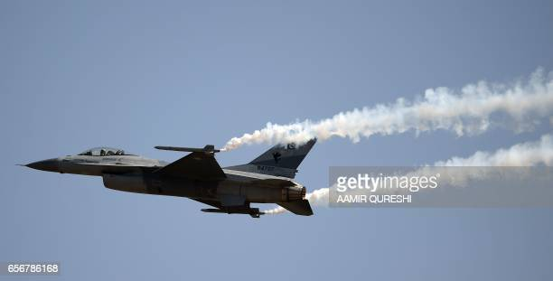 A Pakistani F16 fighter jet flies past during a Pakistan Day military parade in Islamabad on March 23 2017 Pakistan National Day commemorates the...