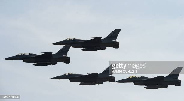 Pakistani F16 fighter jets fly past during a Pakistan Day military parade in Islamabad on March 23 2017 Pakistan National Day commemorates the...