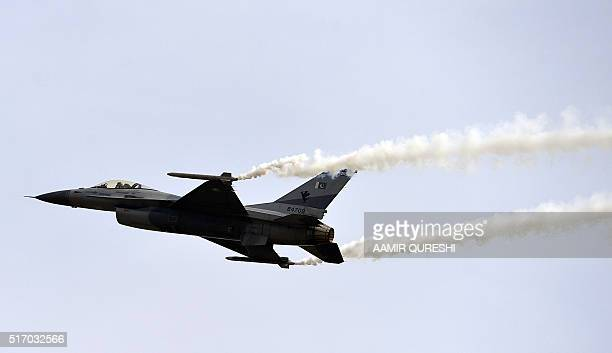 A Pakistani F16 fighter performs a flypast during the Pakistan Day military parade in Islamabad on March 23 2016 Pakistan National Day commemorates...