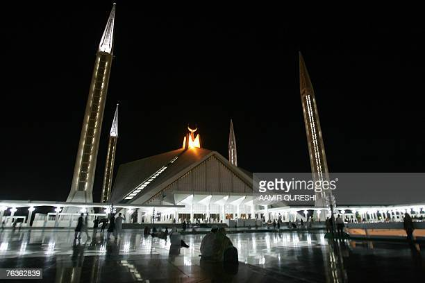 Pakistani faithful Muslims arrive to pray during a special night prayer at the Faisal Mosque to mark ShabeBarat or night of forgiveness in Islamabad...
