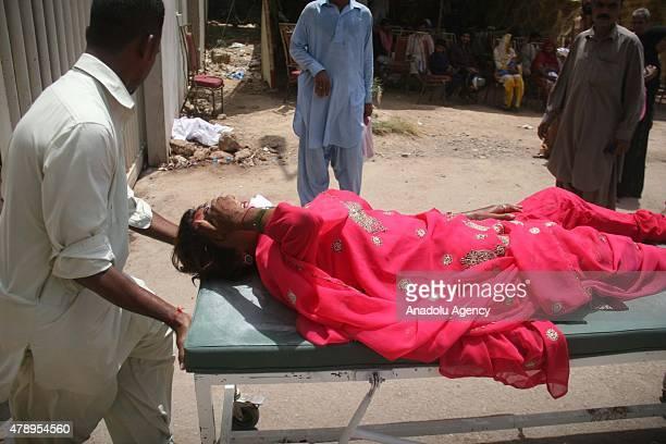 Pakistani family members bring an elderly woman suffering from a heatstroke to a hospital in Karachi Pakistan Monday June 29 2015 A Pakistani...