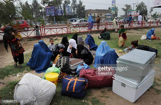 A Pakistani family wait for transport at the bus stop during the transport strike in Peshawar on April 10 against raised petrol prices Pakistan on...