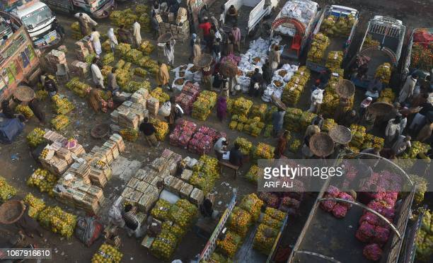 TOPSHOT Pakistani farmers gather at a fruit market in Lahore on December 3 2018