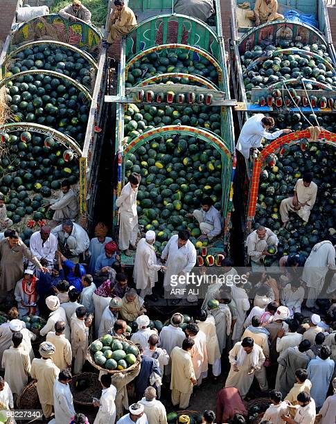 Pakistani farmers sit on truck loaded with watermelon as they bargain with dealers at a fruit market in Lahore on April 3 2010 Last fiscal year...