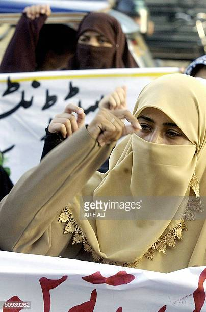 Pakistani female activists of the Imamia Students Organisation shout slogans during a demonstration in Lahore 08 June 2004 The demonstrators were...
