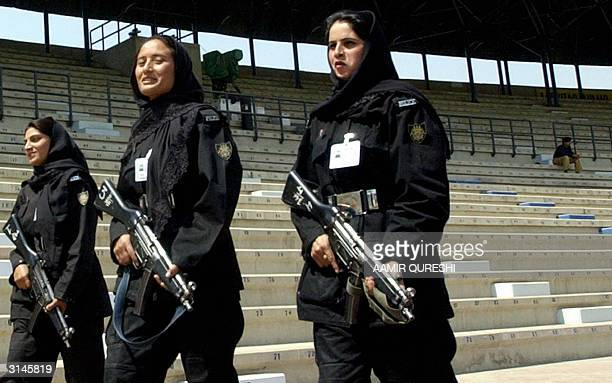 Pakistani female police women carrying automatic weapons patrol during a practice session of Pakistani and Indian cricket teams at Multan Cricket...