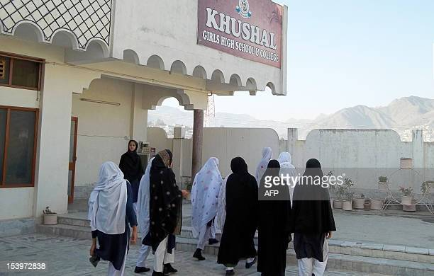 Pakistani female students arrive at the school of child activist Malala Yousafzai who was shot in the head in a Taliban assassination attempt in...