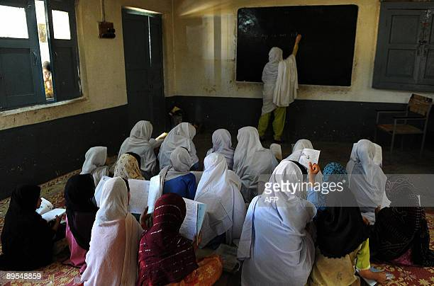 A Pakistani female teacher gives a lesson at a girl's school in Mingora the main town of Swat valley on August 1 2009 Schools reopened in Pakistan's...