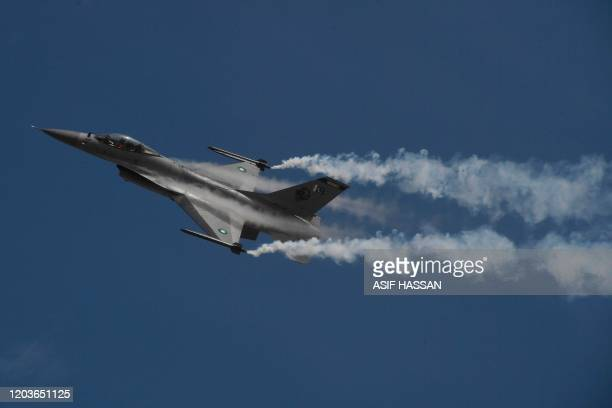 A Pakistani fighter jet F16 flies over Karachi on February 27 2020 during a ceremony to commemorate Pakistan Air Force's 'Operation Swift Retort'...