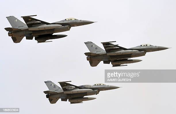 Pakistani fighters F16 fly on November 4 2013 during in the AzmeNau4 military exercise in Khairpure Tamay Wali in Bahawalpur distirict Pakistani...