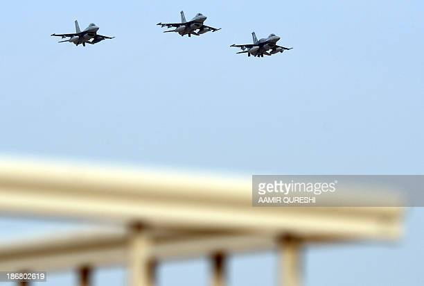 "Pakistani fighters F-16 take part in a fly past on November 4, 2013 during in the Azm-e-Nau-4"" military exercise in Khairpure Tamay Wali in..."