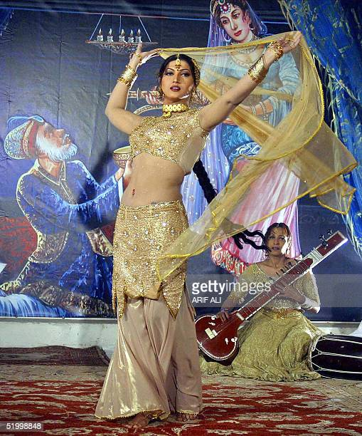 Pakistani film actress Sana dances during the shooting of the film 'Dako Hasina' in Lahore 16 January 2005 Pakistan's film industry known as...