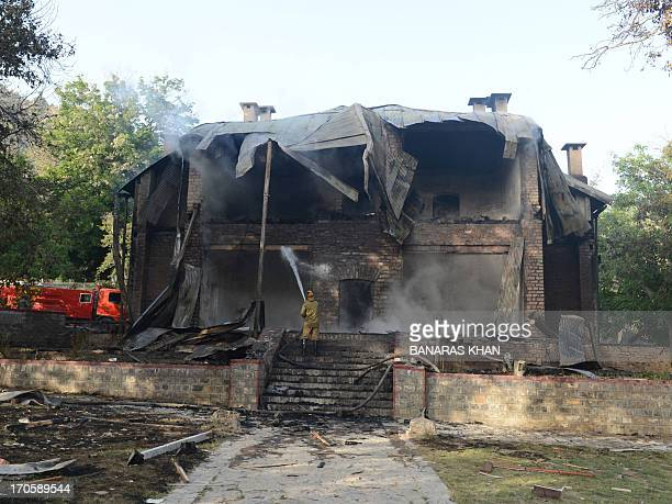 A Pakistani firefighter extinguishes a blaze which gutted a historical building in Ziarat 80 kilometres southeast of Quetta on June 15 2013 Militants...