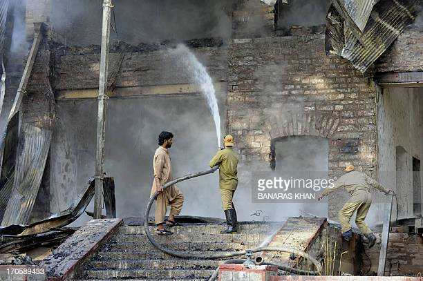 Pakistani firefighters extinguish a blaze which gutted a historical building in Ziarat 80 kilometres southeast of Quetta on June 15 2013 Militants...