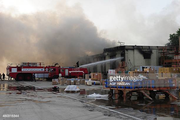 Pakistani firefighters extinguish fires after militants attack Jinnah International Airport in Karachi on June 9 2014 Pakistan's security forces said...