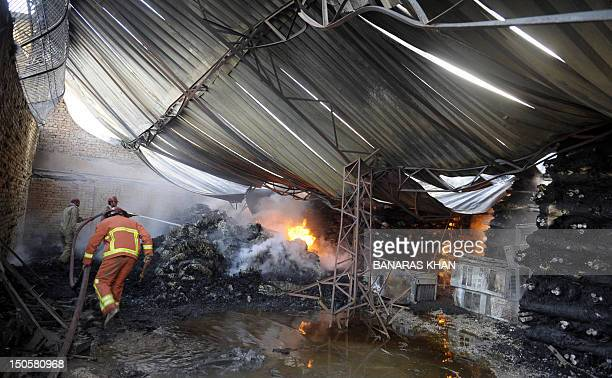 Pakistani firefighters try to extinguish a fire at a warehouse of the United Nations High Commissioner for Refugees in Quetta on August 22 2012 AFP...
