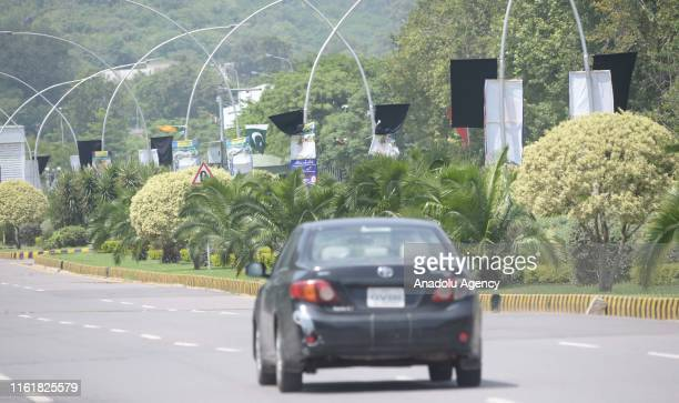 Pakistani flags fly at halfmast on Constitution Avenue as the country observes Black Day to mark India's Independence Day after it revoked the...